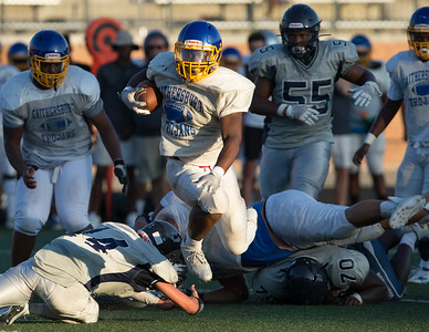 August 29, 20119 - The run to daylight by Gaithersburg included solid offense line play and a side-step of the diving Magurder Middle Lineback. Photo by Mike Clark/The Montgomery Sentinel