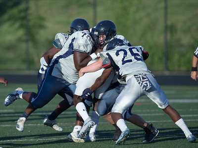 August 29, 2019 - The Magruder defense smothers the Gaithersburg Running Back during the pre-season scrimmage. Photo by Mike Clark/The Montgomery Sentinel