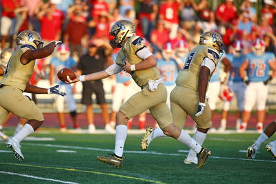 George P. Smith/The Montgomery Sentinel    Good Counsel's Trace Ccampbell (6) handing off to Sy'Veon Wilkerson (3).