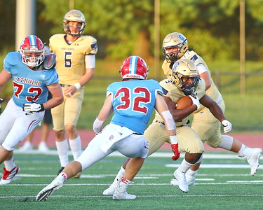George P. Smith/The Montgomery Sentinel    Good Counsel's Sy'Veon Wilkerson (3) hitting the gap.