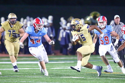 George P. Smith/The Montgomery Sentinel    Good Counsel's Sean Aaron (15) stutter-stepped to try and throw Charlotte Catholic's Liam Barbee (44) off balance.