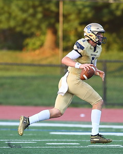 George P. Smith/The Montgomery Sentinel    Good Counsel's Trace Campbell (6) looks for receivers downfield after being flushed out of the pocket.