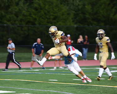 George P. Smith/The Montgomery Sentinel    Good Counsel's Sy'Veon Wilkerson (3) hurdles Charlotte Catholic's Joseph Sartori (3) trying to avoid being tackles enroute to scoring a touchdown. Unfortunately the effort was for naught due to a penalty.