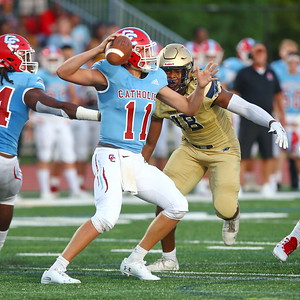 George P. Smith/The Montgomery Sentinel    Good Counsel's DE Kristopher Jenkins (18) converges on Charlotte Catholic quarterback Jake Smith (11).