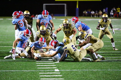 George P. Smith/The Montgomery Sentinel    Charlotte Catholic players recovered their own fumble and were forced to punt.