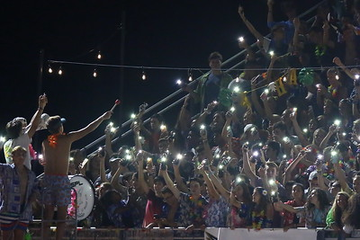 George P. Smith/The Montgomery Sentinel    The Good Counsel student section with their cell phone lights on - 21st century lighters.