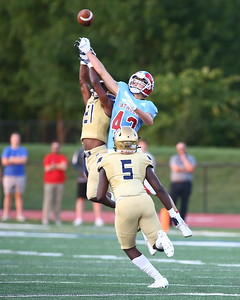 George P. Smith/The Montgomery Sentinel    Good Counsel's safety Nicolas Ware (21) disrupts this pass to Charlotte Catholic's Jason Jeffares (43) that resulted in a Falcon interception.