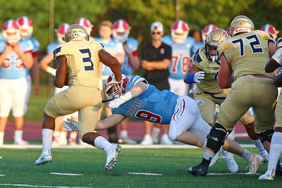 George P. Smith/The Montgomery Sentinel    Good Counsel's Sy'Veon  Wilkerson (3) escapes this diving tackle by Charlotte Catholic's  and bounced outside for additional yardage.
