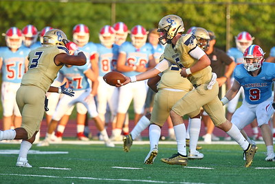 George P. Smith/The Montgomery Sentinel    Good Counsel's Trace Campbell (6) handing off to Sy'Veon Wilkerson (3).