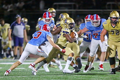 George P. Smith/The Montgomery Sentinel    Good Counsel's running back LeJay Hatcher (26) slices through the Cougar line as Charlotte Catholic's corner back Joseph Sartori (3) gives chase.