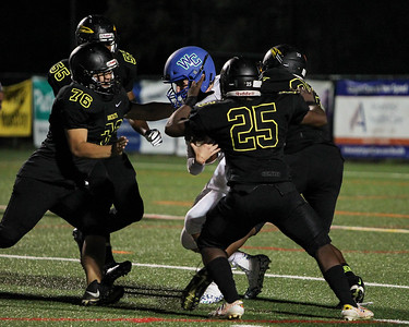 September 13, 2019: Richard Montgomery defenders sack Churchill Cole Haglund (9) during HS football action between Churchill HS and Richard Montgomery HS in Rockville, MD. Photos by Chris Thompkins/Montgomery County Sentinel