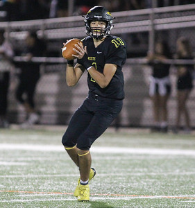 September 13, 2019: Richard Montgomery Justin Steele (11) looks for an open reciever during HS football action between Churchill HS and Richard Montgomery HS in Rockville, MD. Photos by Chris Thompkins/Montgomery County Sentinel