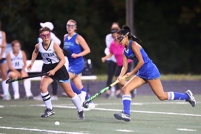 George P. Smith/The Montgomery Sentinel    Churchill's Natalie Heshmat (10) moves the ball up the field with Whitman's Alex Robinson (9) in pursuit.