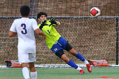 George P. Smith/The Montgomery Sentinel    Gaithersburg's Jonathan Lovo (1) made this diving stop to keep the Trojans in the game.