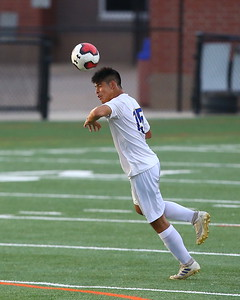George P. Smith/The Montgomery Sentinel    Gaithersburg's Deigo Benitez (15) heading the ball.