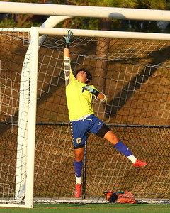 George P. Smith/The Montgomery Sentinel    Gaithersburg's Jonathan Lovo (1) touches the crossbar as the ball sails above.