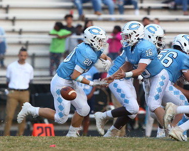 George P. Smith/The Montgomery Sentinel    Clarksburg quarterback Nick Bolling (16) looses the ball as he tries to hand off to his running back Aidan McCloskey  (20).