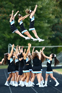 George P. Smith/The Montgomery Sentinel    A trio of cheerleaders fly for Clarksburg.