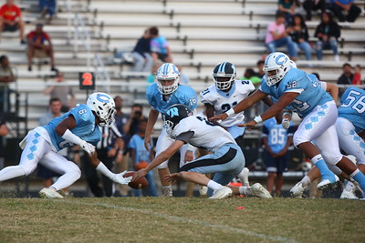 George P. Smith/The Montgomery Sentinel    Whitman's Arthur Dehareng (24) seems poised to recover a Clarksburg fumble but Clarksburg's Aidan McCloskey (20) (behind 52) somehow got back to recover his own fumble.