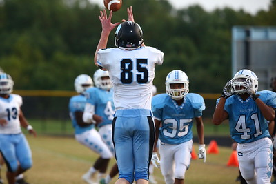 George P. Smith/The Montgomery Sentinel    Whitman's Spencer Caverly (85) makes another catch among the Clarksburg defenders.