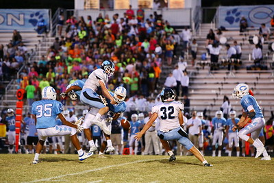 George P. Smith/The Montgomery Sentinel    Clarksburg's Xavier Holmes (2) can hold on to a high throw in triple coverage.