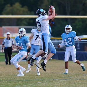 George P. Smith/The Montgomery Sentinel    Whitman's Spencer Caverly (85) makes a catch while closely  defended by Clarksburg's Giovanni Marc (9).