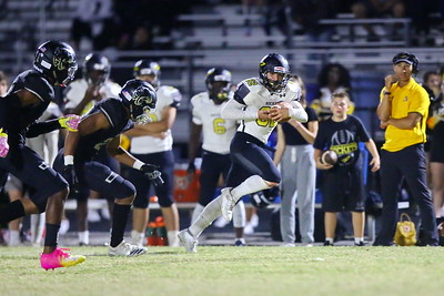 George P. Smith/The Montgomery Sentinel    Richard Montgomery's Dylan Lowe (82) gains additional yardage after making a catch of the left side of the field.
