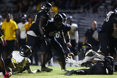 George P. Smith/The Montgomery Sentinel    Richard Montgomery's T'Kai Ayoola (13) recovers a Northwest fumble.