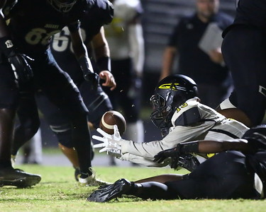 George P. Smith/The Montgomery Sentinel    Richard Montgomery's Tidiane Epps (13) recovers a Northwest fumble.
