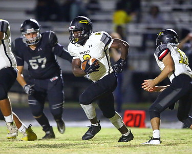 George P. Smith/The Montgomery Sentinel    Richard Montgomery's Delvin Cole (6) takes the hand off from Ari Morton (12).