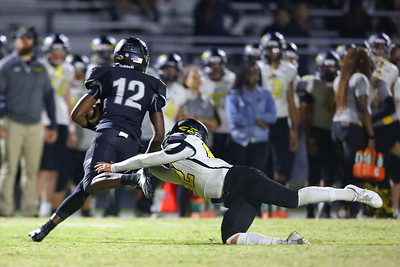 George P. Smith/The Montgomery Sentinel    Richard Montgomery's Dylan Lowe (82) dives for Northwest's Tyree Edwards (12) and gets him.