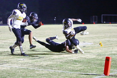 George P. Smith/The Montgomery Sentinel    Richard Montgomery's T'Kai Ayoola (9) escapes the diving tackle attempt by Northwest's MJ Johnson (21) but loses his balance trying to get to the pylon as a flag comes in.
