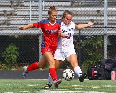 George P. Smith/The Montgomery Sentinel    Wootton's Paige Abid (15) and Sherwood's Samantha Godfrey (11) battle for control of the ball.