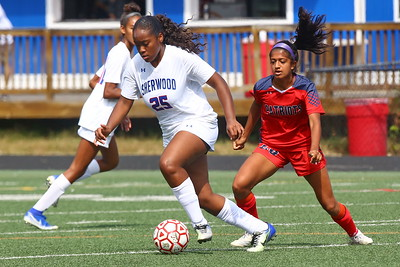 George P. Smith/The Montgomery Sentinel    Sherwood's Chase Bell (25) dribbling toward the Wootton goal with Wootton's Sabrina Shah (20) in pursuit.