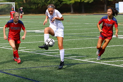 George P. Smith/The Montgomery Sentinel    Sherwood's Lucy Sokol (17) settles the ball between Wootton defenders.