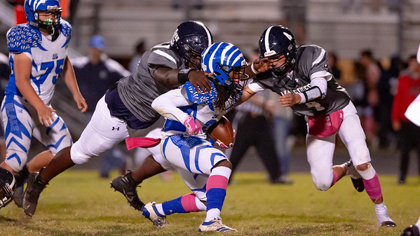 October 4, 2019 - The Magruder Colonels defense hold down Blake's Sabionn Adams on this play but Adams and the rest of the Blake offense mounted their game winning drive with only seconds to go. Photo by Mike Clark/The Montgomery Sentinel