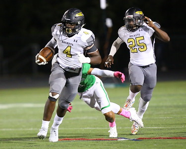 George P. Smith/The Montgomery Sentinel    After an interception, Richard Montgomery's Shazali Audu (4)escapes the diving tackle by Walter Johnson's Kai Holloway (1) to complete a pick-six early in the game against Walter Johnson on Friday, October 4, 2019.
