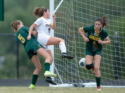 October 7, 2019 - Diana Clay (3) and Skylar Pencek (5) of Damascus combine to keep Poolesville's Sabrina Edwards away from the goal. Photo by Mike Clark/The Montgomery Sentinel
