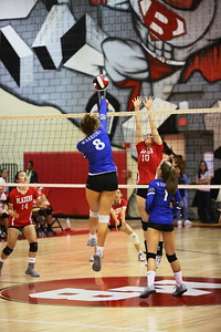 George P. Smith/The Montgomery Sentinel    Sherwood's Gwen Eustace fires a spike as Blair's Karen Yang (10) tries to block.