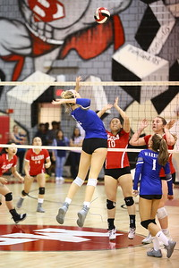 George P. Smith/The Montgomery Sentinel    Sherwood's Grace Aceto (9) about to lower the boom on Blair.