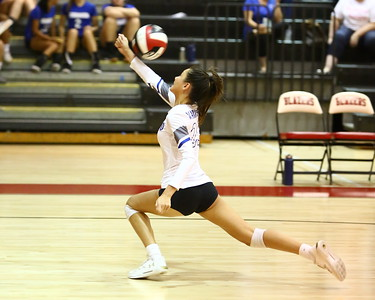 George P. Smith/The Montgomery Sentinel    Sherwood's Sydney Spillman (23) saves a deep ball in the game agaisnt Blair that Sherwood won in straight sets.