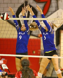 George P. Smith/The Montgomery Sentinel    Sherwood's Ashley Hinerman (9) and Grace Aceto (5) block a Blair shot at the net.