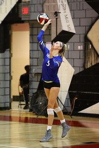 George P. Smith/The Montgomery Sentinel    Sherwood's Grace Aceto (5) serving against Blair.