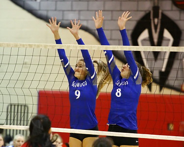 George P. Smith/The Montgomery Sentinel    Sherwood's Ashley Hinerman (9) and Gwen Eustace (8) go up to block a Blair kill.