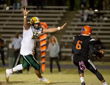 October 11, 2019 - Top national recruit Brian Bresee of Damascus flushes Watkins Mill Quarterback Kyle Wingate from the pocket and then gets the sack. Photo by Mike Clark/The Montgomery Sentinel