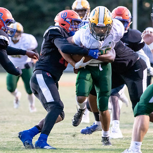October 11, 2019 - Damascus Wide Receiver Chris Shaw drags Watkins Mill defenders during the 49-14 win by visiting Damascus. Photo by Mike Clark/The Montgomery Sentinel