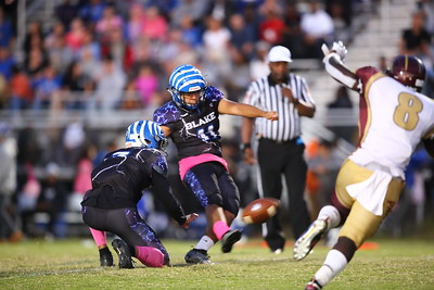 George P. Smith/The Montgomery Sentinel    Paint Branch's Denzel Esambe (8) tries to block a PAT by Blake's Ricky Perez (11) off the hold by Cyrus Wilson (3).
