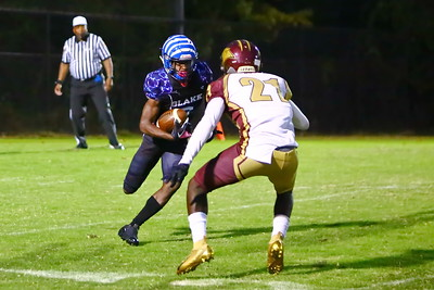 George P. Smith/The Montgomery Sentinel    Blake's Malachi Herring (20) with the punt return tries to get around Paint Branch's CHauncey Spikes (21).