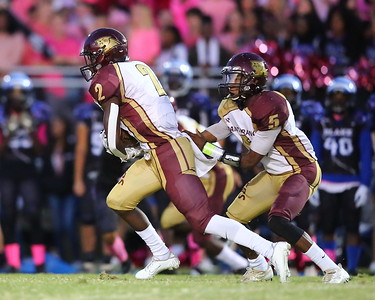 George P. Smith/The Montgomery Sentinel    Paint Branch's Sam Doku (2) takes the hand off from Octavian Smith (5).