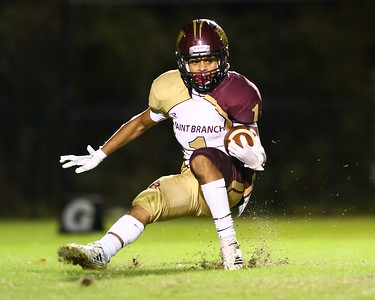 George P. Smith/The Montgomery Sentinel    Paint Branch's Elijah Grooms (1) slams on the brakes to reverse field on a punt return.